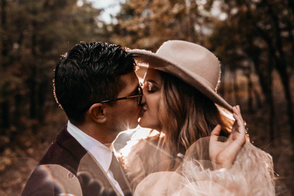 Glam Bride kisses her boho groom